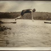 A person diving into a lake