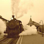 A steam train going down some tracks