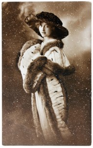 A women wearing a winter coat in a snow storm
