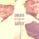 Two guys, with hard hats, standing back to back - Create a culture of safety