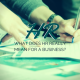Person writing on a piece of paper - HR, What does HR really mean for your business?