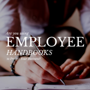 Person writing on a piece of paper - Employee Handbooks