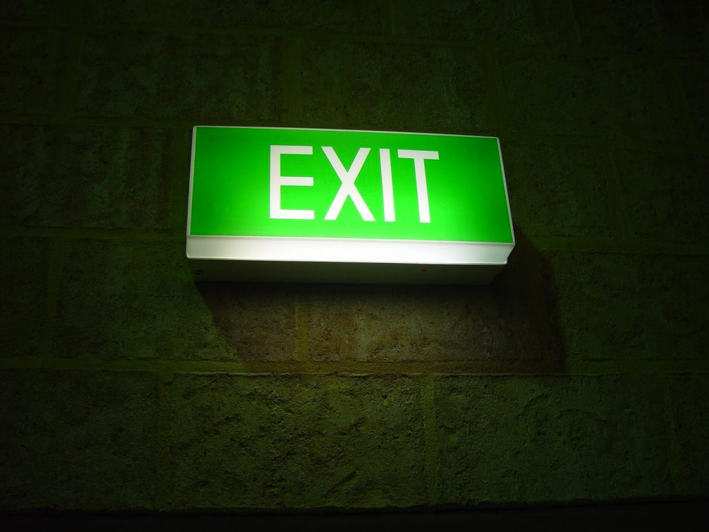 Green glowing exit sign