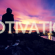 Person, standing on the top of a hill, looking at the sun coming up over a city below. Title - Motivation