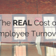 Conference room table with brick wall on the background. Title - The REAL cost of employee turnover