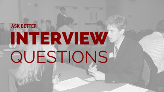 Many people in a room, sitting at tables, interviewing other people. Title - Ask better interview questions