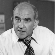 Head shot of Lou Grant in black and white