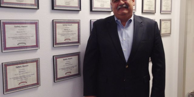 Oscar standing next to a wall covered in ERM Safety Awards