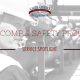 Worker walking down a corridor with large pipes on the side of him. He is wearing a hard hat. Title - Work Comp & Safety Programs - Service Spotlight