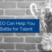 Trophy being held up with one hand and a brick wall in the background and title - How a PEO Can Help You Win the Battle for Talent