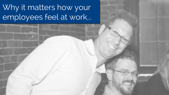 Two Employees smiling and looking at the camera with title - Why it matters how your employees feel at work