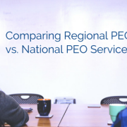 The back of two employees at a conference table with coffee mugs on the table and title - Comparing Regional PEO vs National PEO Service