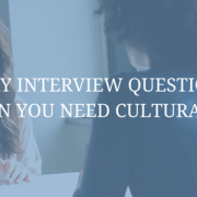 feature image interview question ideas when you need cultural fit blue image with two women speaking in interview