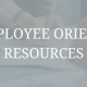 "image of multiple hands picking up papers off a table and writing on paper. Image has a transparent grey filter over it with words in white that say, ""New employee orientation resources"""