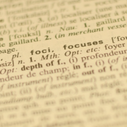 "image of a page in the dictionary. Image is faded out except for the word ""focus"" and its definition"