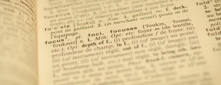 """image of a page in the dictionary. Image is faded out except for the word """"focus"""" and its definition"""