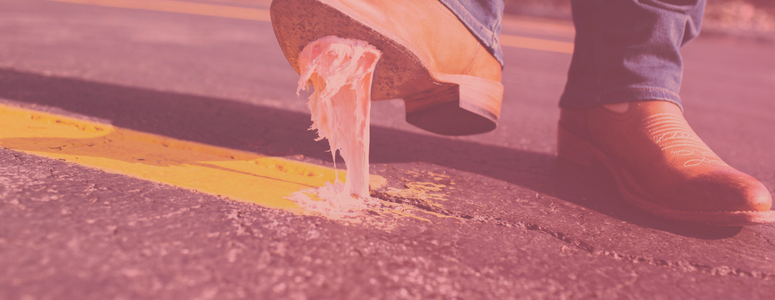 Image of someone stepping on gum wearing tan work boots
